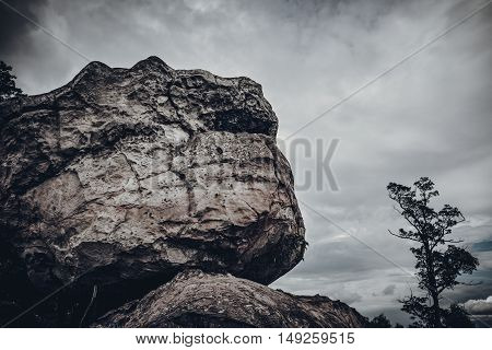 Boulders against sky with cloudy over tranquil nature outdoor at the daytime. Beauty landscape from national park. Low key and vintage tone effect.