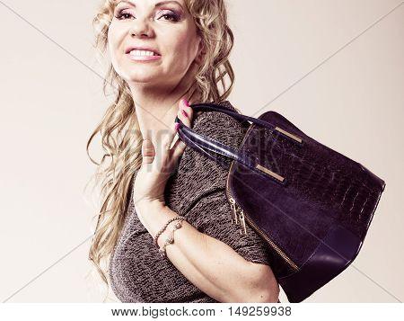 Mature Lady With Handbag.