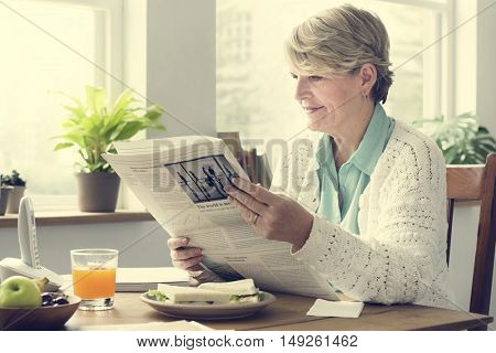 Senior Adult Reading Newspaper Leisure Concept