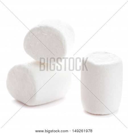 Fluffy white marshmallow macro isolated over white background. Heap of white marshmallows