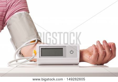 Female hand with electronic pressure measuring instrument over white background