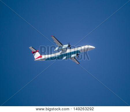 Propeller Passanger Airplane On Blue Sky