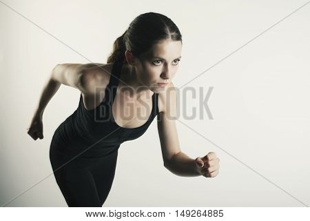 Competitive Female Athlete Running - Isolated Over Grey Background