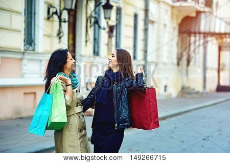 beautiful young girls having fun in the city doing shopping
