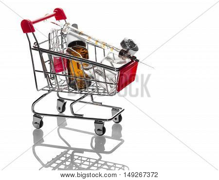 medications in the trolley on a white background