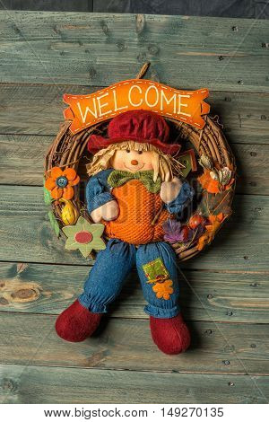a doll talk welcome on a wooden background