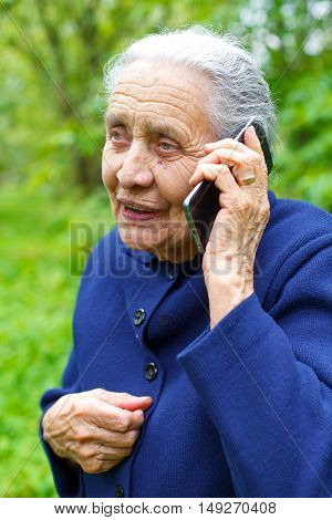 Picture of a happy old woman talking on the phone