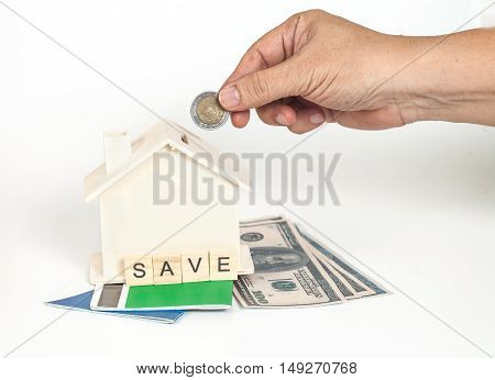 Miniature house with book bank white background