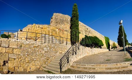 Panoramic view on sandstone wall ruins in Tarragona, summer Spain
