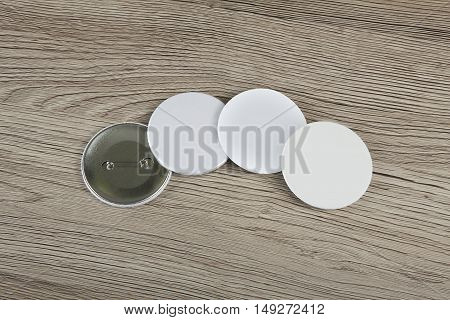White Badges front and back view on a wooden background