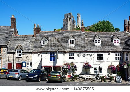 CORFE, UNITED KINGDOM - JULY 19, 2016 - View of Corfe castle seen above The Greyhound Pub Corfe Dorset England UK Western Europe, July 19, 2016.