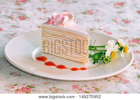 Vanilla Crepe Cake Topping With Strawberry Sauce. It Looks Fresh And Delicious And It Is My Favorite