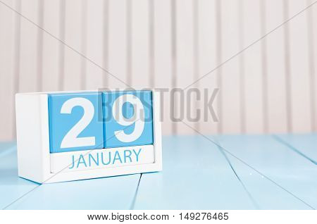 January 29th. Day 29 of month, calendar on wooden background. Winter at work concept. Empty space for text.