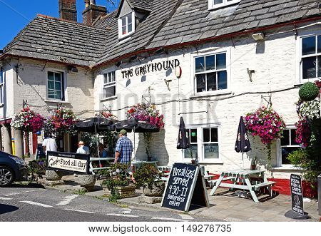 CORFE, UNITED KINGDOM - JULY 19, 2016 - View of The Greyhound pub in the centre of the village Corfe Dorset England UK Western Europe, July 19, 2016.