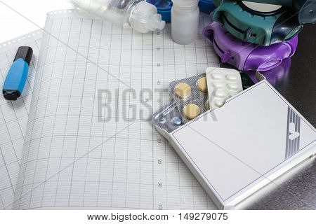 Asthma allergie illness relief concept salbutamol inhalers aerosol medication drugs and paper on chrome background