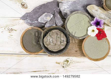 Ancient minerals - green and blue clay powder and mud mask for spa beauty concept