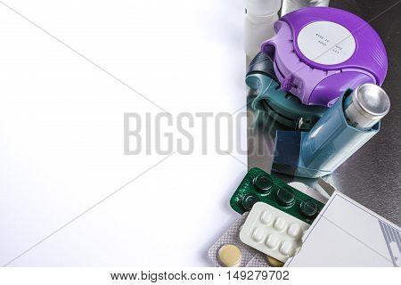 Asthma allergie illness relief concept salbutamol inhalers aerosol medication drugs copy space