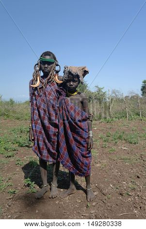 Mursi tribe girls - 05 october 2012, Omo valley, Ethiopia