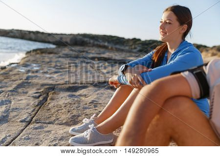 Couple in sport wear on beach