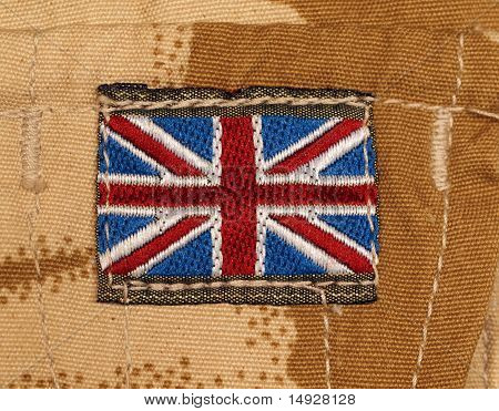 British Army Badge On Desert Camouflage