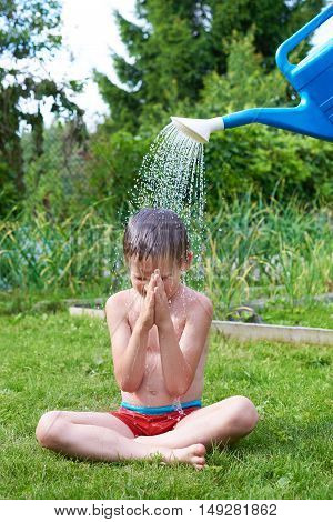 Little Boy Pouring Water From Watering Can