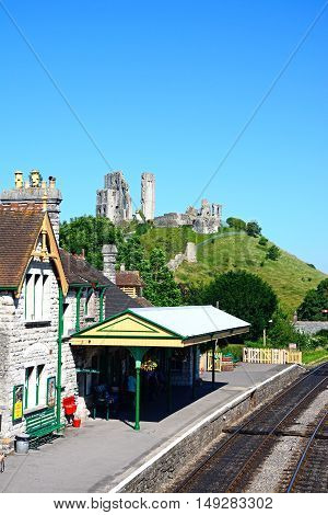 CORFE, UNITED KINGDOM - JULY 19, 2016 - View of the railway station with the castle to the rear Corfe Dorset England UK Western Europe, July 19, 2016.