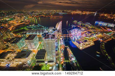 Aerial night view of Yokohama Cityscape and bay at Minato Mirai waterfront district from yokohama landmark tower