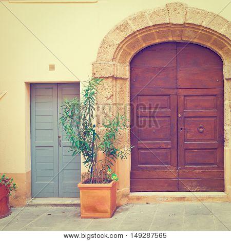 Wooden Ancient Italian Door in Historic Center Instagram Effect
