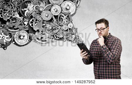 Man using digital tablet . Mixed media