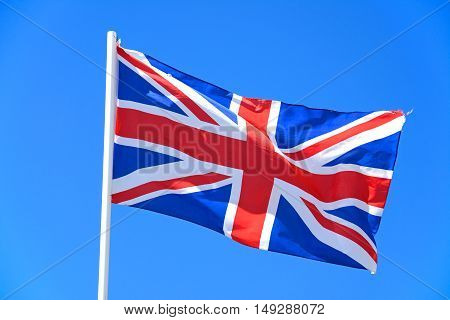 Union jack flag against a blue sky UK.