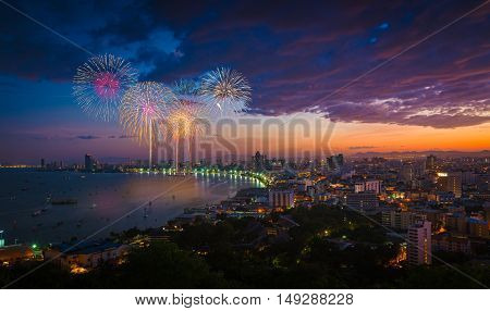 Multicolor fireworks night scene blurred photo pattaya cityscape sea beach view thailand