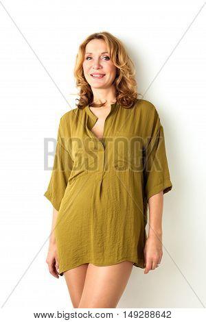 Baeutiful adalt woman standing near the wall