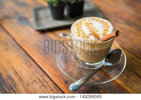 A Cup Of Cafe Latte On Wood.