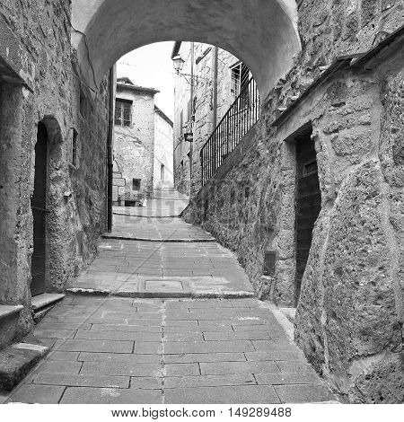 Narrow Street with Old Buildings in Italian City of Sorano Retro Image Filtered Style