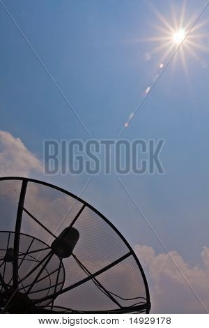 Satellite Receiver Pointing To The Sun Vertical