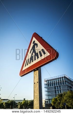 Traffic sign to pedestrians in a street in Spain