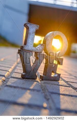 Love Sign With Metal Letters In A Street