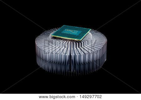 Computer processor chip CPU with aluminum cooler on black reflective background