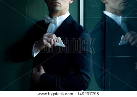 Man In Suit Touches Handkerchief