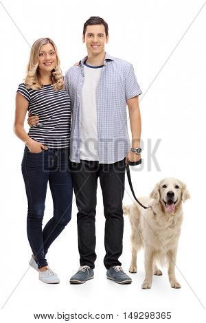 Full length portrait of a young couple posing with their dog isolated on white background