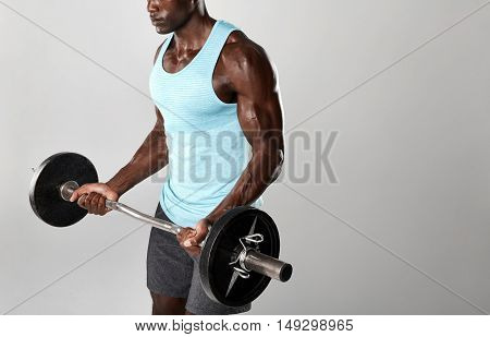 Fitness Model Working Out With Weights On Grey Background