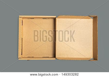 Empty shape box made of cardboard on dark background.