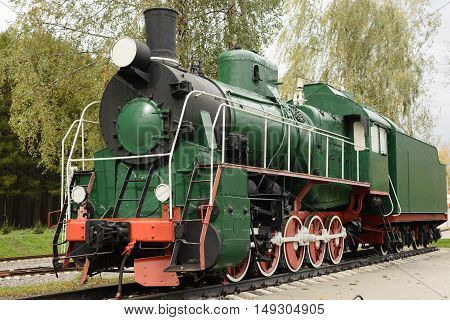 Side View Of Old Green, Steam Locomotive