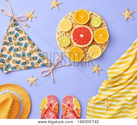 Fashion. Tropical Fresh Summer Set. Fashion Design. Bright Color. Fashion Stylish Accessories Fruit. Citrus. Fashion Glamor woman Swimsuit Bikini. Minimal. Top View. Creative Art Concept. Essentials