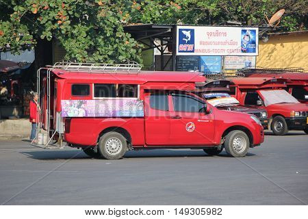 CHIANG MAI, THAILAND - FEBRUARY 28 2015: Red taxi Chiang Mai at Taxi to City Center. Photo at Chiangmai bus station, thailand.