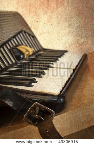 Old accordion instrument in grunge style. Shallow depth of field.