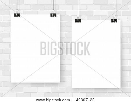 Posters template on white brick wall. Realistic wall gallery vector illustration. Set of colorful empty vector mockups for your illustrations drawings posters or photos.