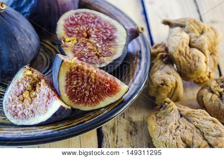 fresh and dried figs on a wooden table