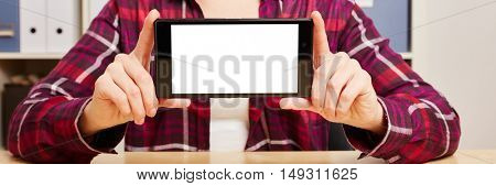 Hands of a woman holding a smartphone with an empty touchscreen