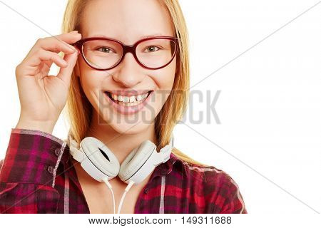Young girl smiles and holds her hand on her glasses